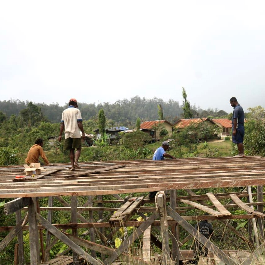 Young people build houses in Oksibil.